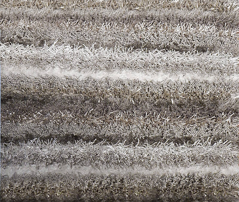 grey brown and white hairy carpet