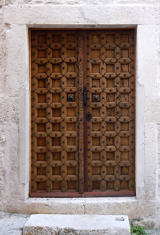 medieval door with rusty nails