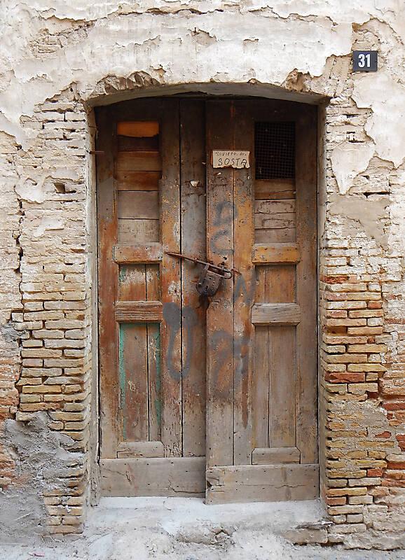 very ruined old door
