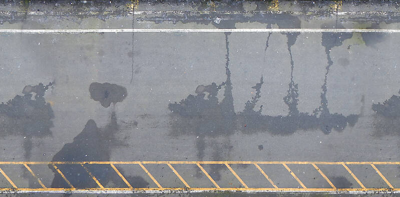 asphalt wet with yellow lines