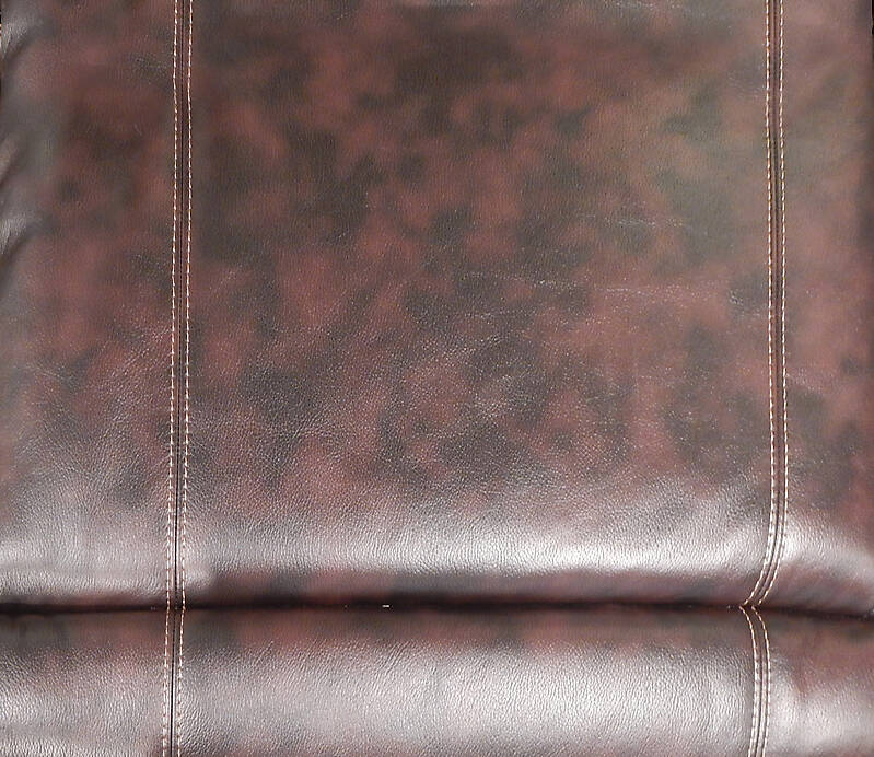 brown leather backrest with sewings