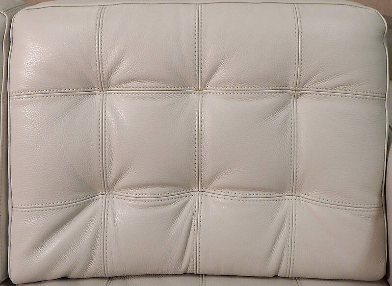 white leather backrest with buttons