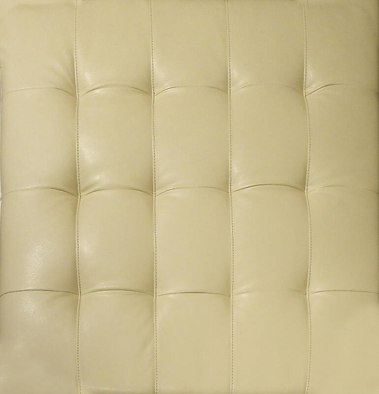 yellow leather backrest with buttons