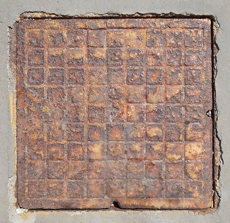 rusty sewer cover 1