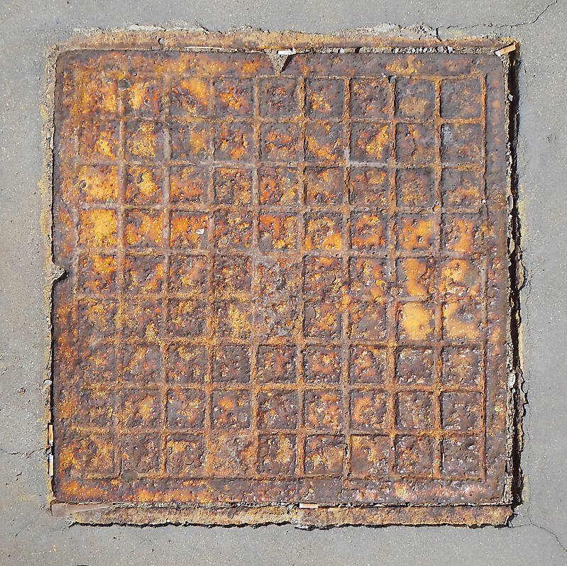 rusty sewer cover 2