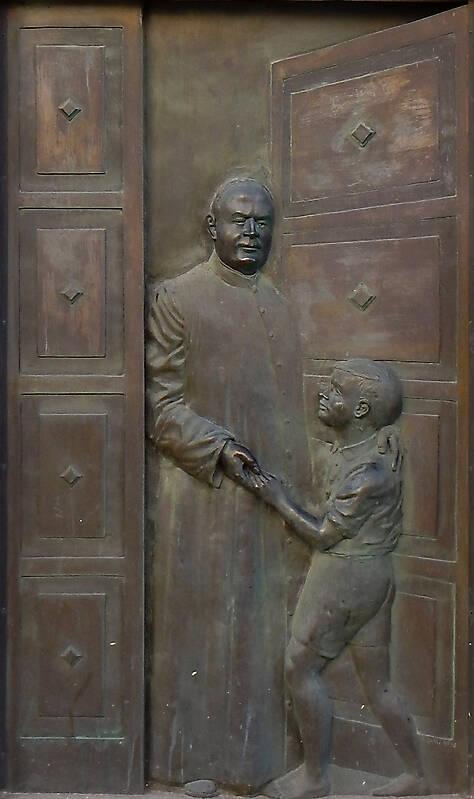 bronze priest and kid ornament