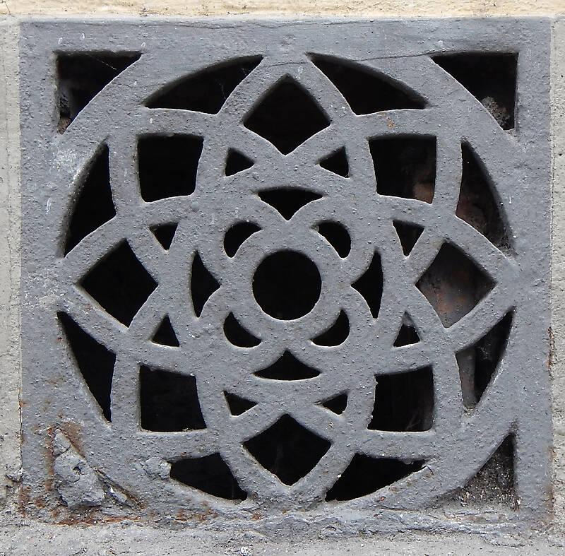 ornate metal little window