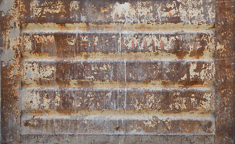 very rusty metal paint box