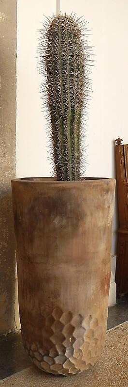 dirt decorated terracotta vase