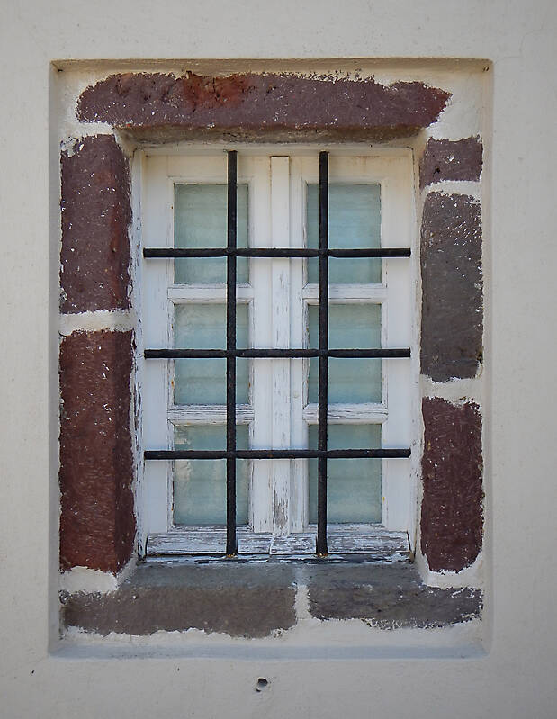 old barred window with stone frame 10
