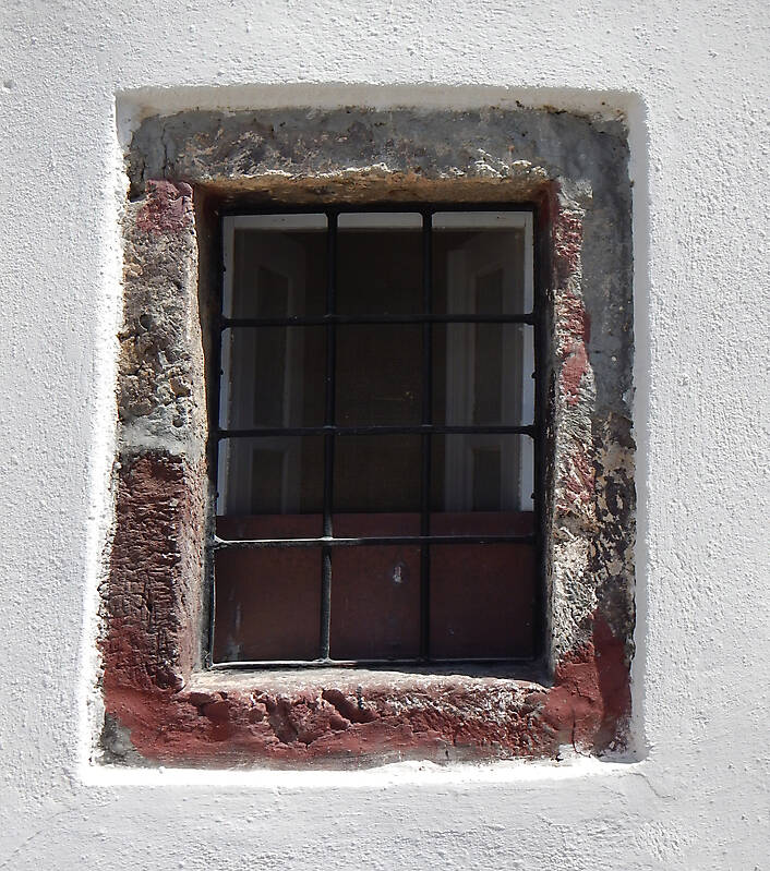 old barred window with stone frame 12