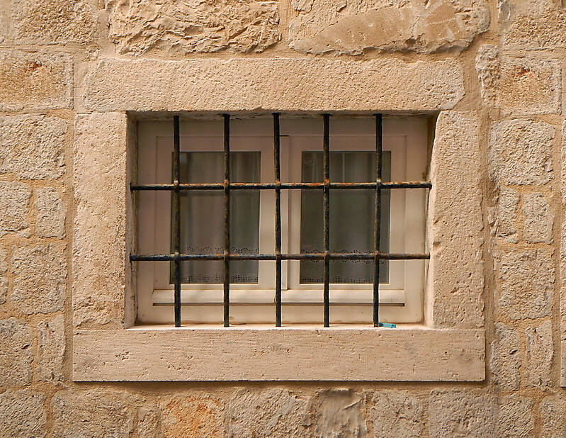 old barred window with stone frame 9