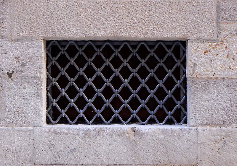 old medieval window with grate 2