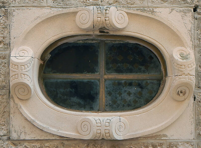 rounded old medieval window with grate 11