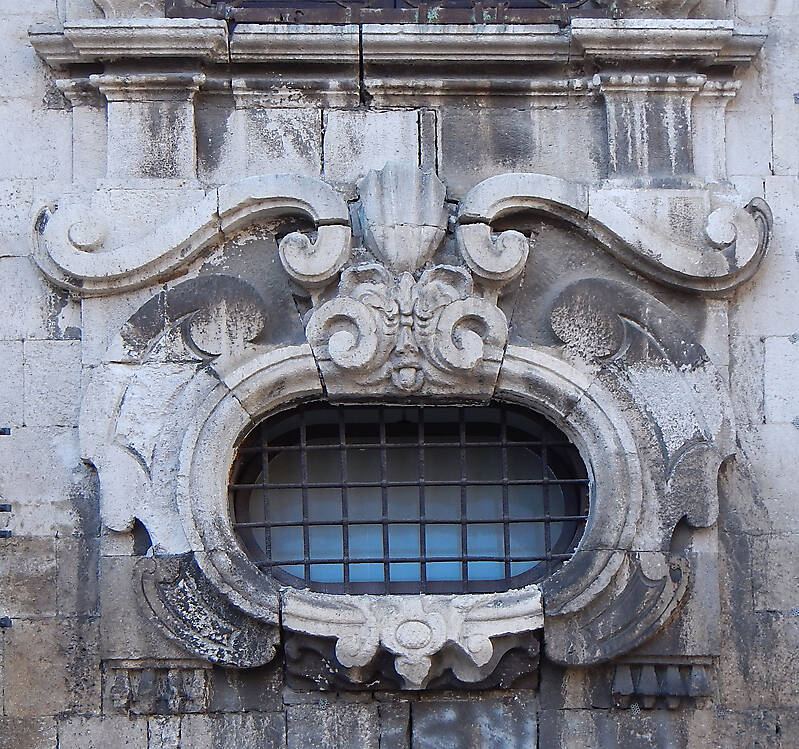 rounded old medieval window with grate 4