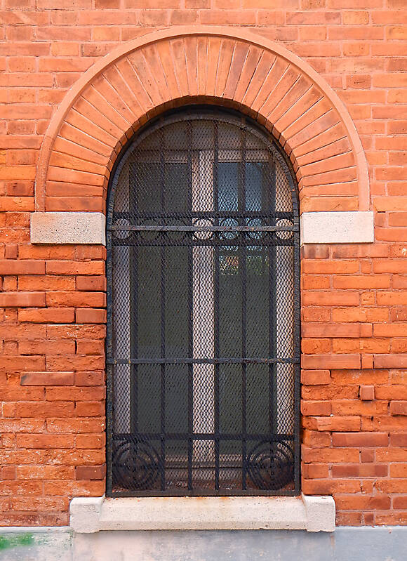 rounded window with cage 2
