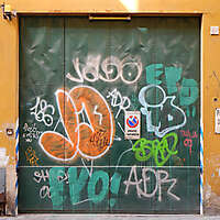 metal garage door with murales