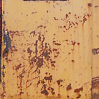 rusty metal door with grate