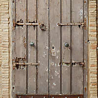 old medieval door with rusty bottom