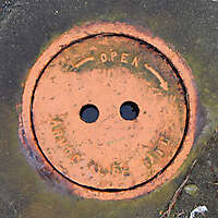 manhole cover orange small