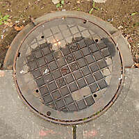 rusty round manhole big 1