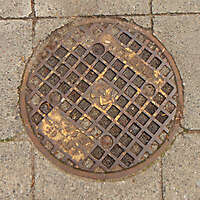 rusty round manhole big 3