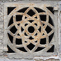 flower design rusty sewer cover