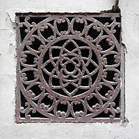 rusty sewer cover with ornaments