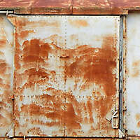 rusty panel with doors