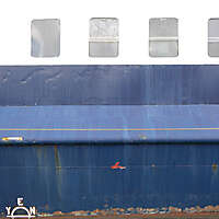 rusty paint ship hull with windows 2