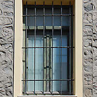 old barred window with stone frame 14