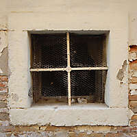 old barred window with stone frame 15