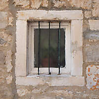 old barred window with stone frame 6