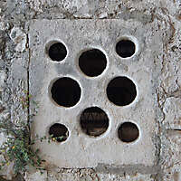 old medieval window holes 14