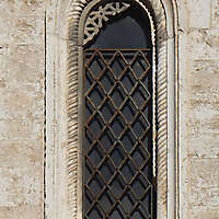 old medieval window with grate 6