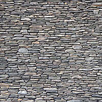 Irregular rock bricks wall dark