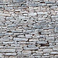 Irregular rock bricks wall