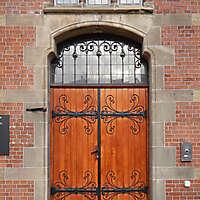 medieval door with 3 celtic windows