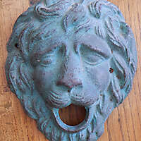 bronze ornament lion face