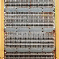 rusty metal panel with holes 2