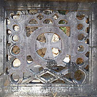decorated stone panel with holes