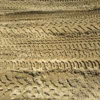 many dirtbike tracks on sand