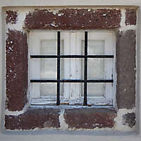 old barred window with stone frame 11