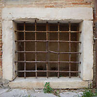 old barred window with stone frame 16
