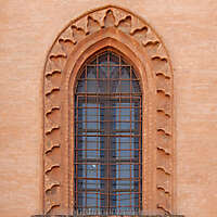 old barred window with stone frame 1