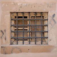 old barred window with stone frame 5