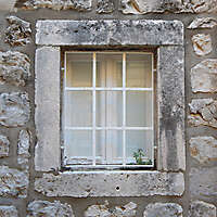 old barred window with stone frame 8