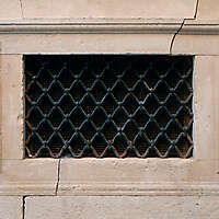 old medieval window with grate 3