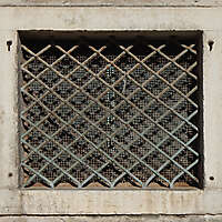 old medieval window with grate 5