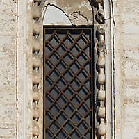 old medieval window with grate 7